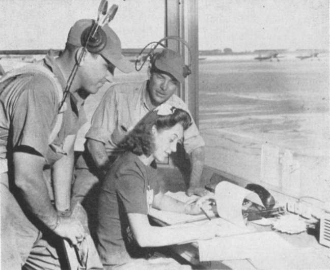 Falcon Flight dispatcher , Wanda Gertje, consults with advanced flight instructors Satchell and Morriss before filing their cross-country flight plans with the C.A.A.