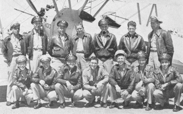 Posed against one of the sturdy Stearmans in which they instructed are members of Squadron 3 , winner of one of the safety contests at Thunderbird II. Left to right, front row : Paul Wertheimer , Aaron Spotswood , Edgar Matson , John Bowers , Horace Hibbard , George Seese , and Edward Salmon. Back row : Fred Logan , Robert Reitford , Marion Snyder , James Baldwin, Lowell Armstrong , James Gannon and Ray LeFever.