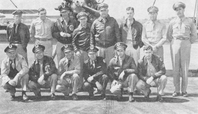 FLIGHT FIVE's safety record topped Thunderbird Field and won for its members the usual monthly reward of a barbecued steak dinner. Left to right back row : Donald R Churchill , John C. Glynn , Lawrence P. Sterns , James L. Lauderdale , William E. Doan , Ray Howes , Phillip P. Carpenter , Frank H. Carson. Front row : Walter G. Palmer , Edmund H Snyder , Catorce A. Hight , E. Earl Warren , William Kelly and Ray V. Wood.