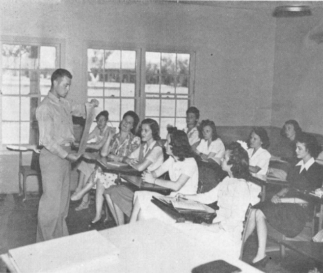 Future feminine flyers at Thunderbird proved themselves adept at absorbing the intricacies of flight. In the classroom scene above, instructor Duane Maley is teaching a course in weather.