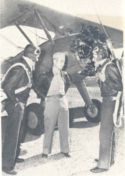 Alejandro N. Pagliere 25 ( left ), and Ignacio F. de Elizalde 27 ( right ), South American Fliers , talk with Mike Des Marais , director of training at Thunderbird II, where they are now employed as primary flight instructors, de Elizalde and Pagliere, who only a short time ago received their flight training in this country, are believed to be the first two Argentinians to become civilian instructors in the AAF training program.