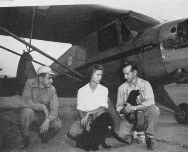 Here's a family group that won't be equalled in many aviation companies, the three Bethancourts, all of whom are flight instructors at Sky Harbor. Left to right : brother Bruce, Wife Bess and Husband Art. In between are Pug, Southwest's only flying canine , who already has some 200 hours to his credit, and Amigo, a newcomer to the Bethancourt family.