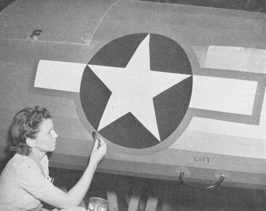 A new type of insigne for army aircrafts was being placed on all planes at Southwest Airways' Fields. Lora Mae Elerick, of Overhaul paint and dope department , is shown putting the finishing touches on the new marking, which the army said, was visible at 60% greater range than either the old device on the Japanese and German markings. The white star on a field of blue was retained, but a white rectangle was added, and the entire emblem enclosed in a red border.