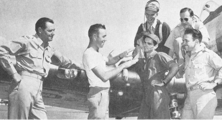 All of flight instructors who worked on Falcon's opening day, on September 29 1941, couldn't be in this picture , but here are some early birds: E.L. Perkins, Dan T. Darnell , Ray Corn and Bob Jones. On the wing: Don Prosser and Ward Miller.