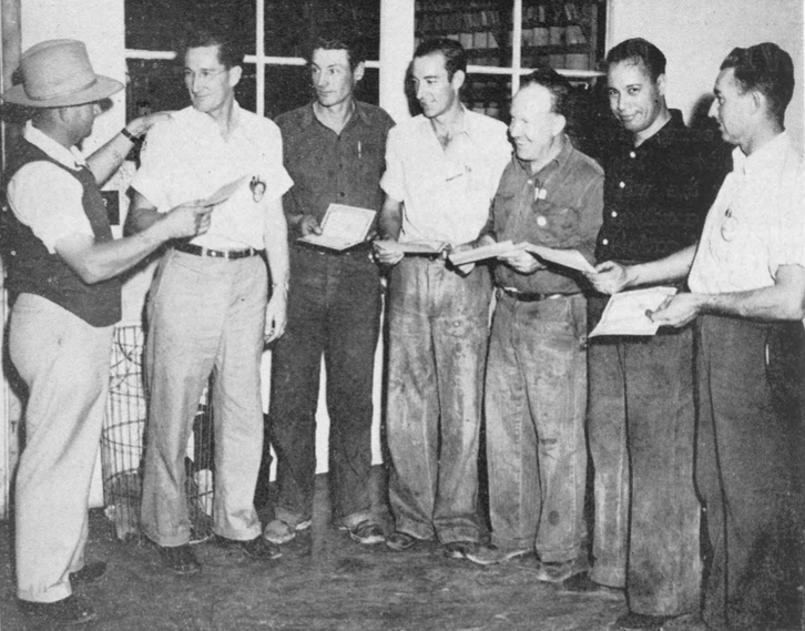 War bonds worth $25 each were awarded to employees in Engine Overhaul who had completed one year or more of service without being absent from work a single day. Felix Kallis , left , Overhaul general manager, presented the prizes to Harry Barnes , superintendent, Kenneth Walker , Bernie Pitman , Neal J. Leiter, Jesus Barraza and John Gregory.